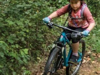 kid mountain biking white Oak Lake